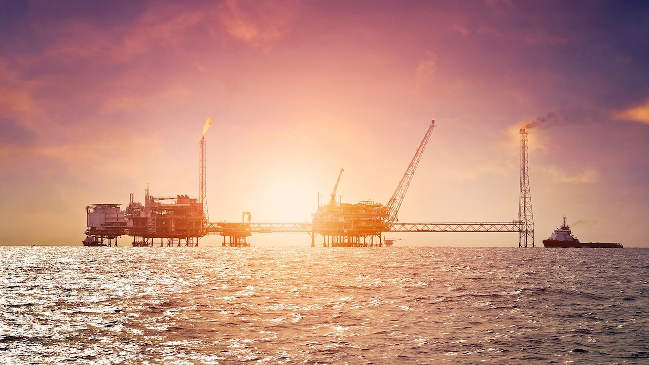 Offshore construction platform for production oil and gas in gulf of Thailand at sunset